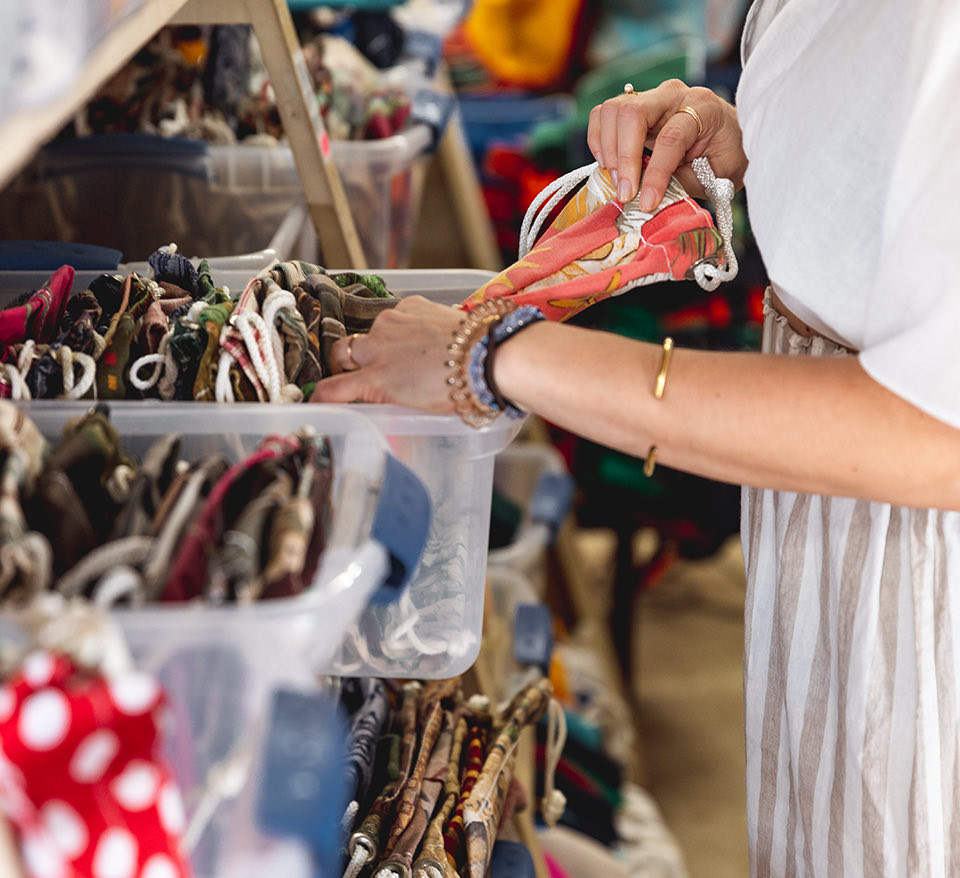 woman picking up a handbag
