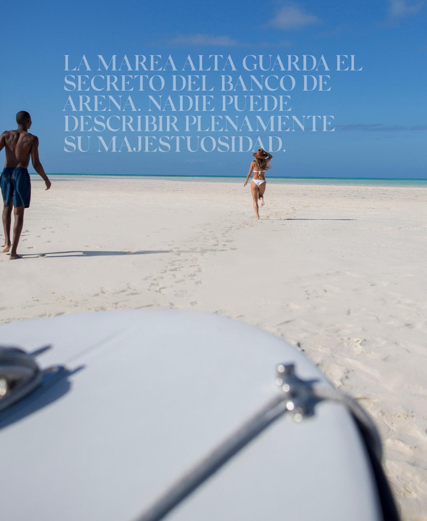 Couples running on a sandbar